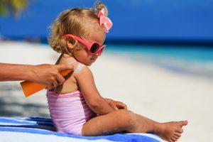 Benefits of Zinc Oxide - Baby wearing sunscreen